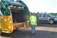 Volunteer Standing by Trash Truck